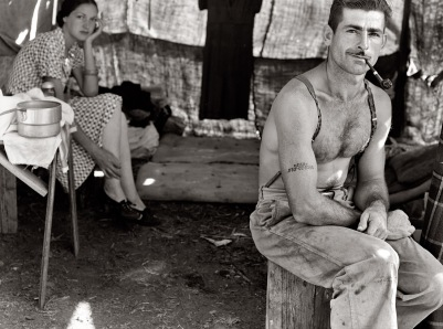 """Oregon, August 1939. """"Unemployed lumber worker goes with his wife to the bean harvest."""""""