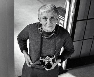 An elder Dorothea Lange with her camera